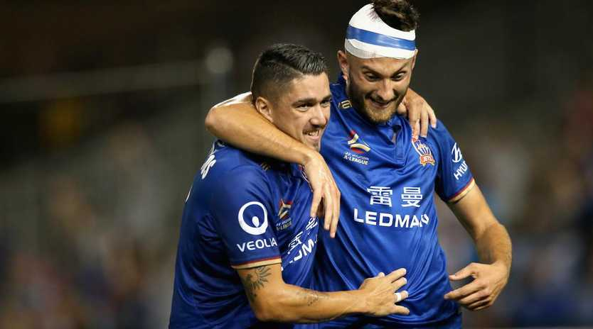 Kaine Sheppard and Dimitri Petratos celebrate the matchwinner. (Ashley Feder/Getty Images