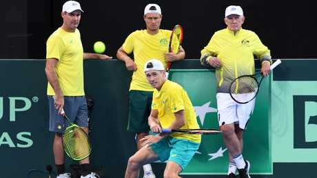 Australian mentors Jaymon Crabb, Lleyton Hewitt and Tony Roche watch Alex de Minaur during a training session. Picture: Dave Hunt/AAP