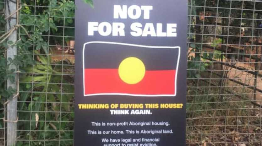 A sign erected outside one of the houses for sale as part of a massive auction of an affordable housing company's properties.