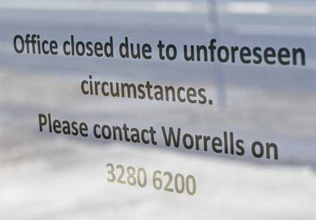 A sign on the door of G.J Gardner homes directs people to an insolvency company.