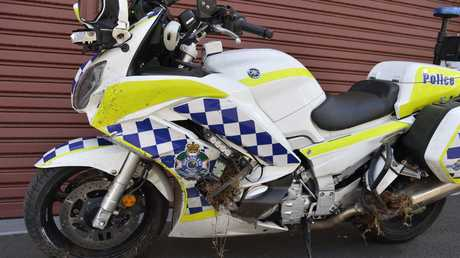 A police motorbike damaged in an incident that left a male sergeant from the Road Policing Command with a dislocated shoulder, rib, hand and ankle injuries, Thursday, January 24, 2019.