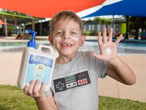 Harlow Axisa, 7, applies sun cream at Bluewater