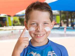 Cooper Axisa, 8, applies sun cream at Bluewater