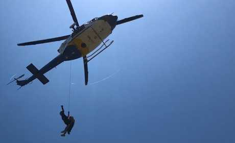 A woman in her 40s was airlifted to hospital after suffering a medical episode on Mount Coolum on Thursday.