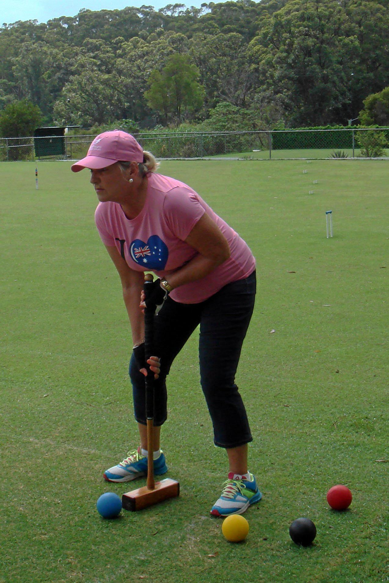Jan Trewhella from the Headland-Buderim Croquet club about to hit off.