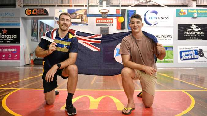 Lukass Blicavs and Jed Zupanovich fly the Queensland State Flag ahead of clashing in the Quest Mackay Australia Day Carnival.