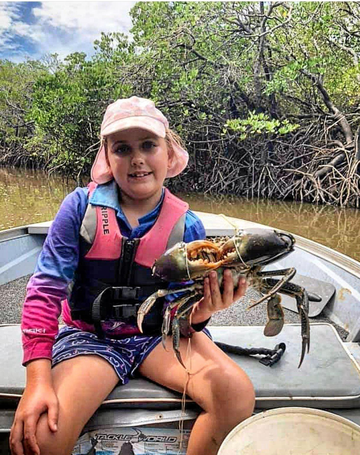 NOT TOO CRABBY: Lily Cheyne with a crab caught at Ballykeel (Sandy Creek).