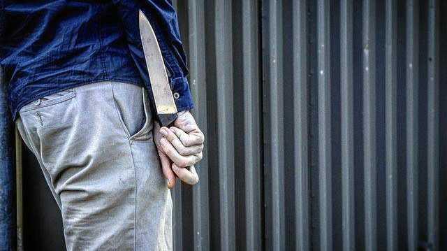 Knife Wielding Neighbour Threatens To Kill Family Friend