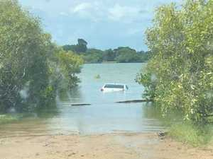Rescue team searches river after car found submerged