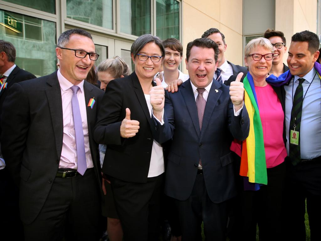 Liberal Senator Dean Smith, with fellow politicians and same-sex marriage campaigners, after his bill passed the senate. Picture: Kym Smith