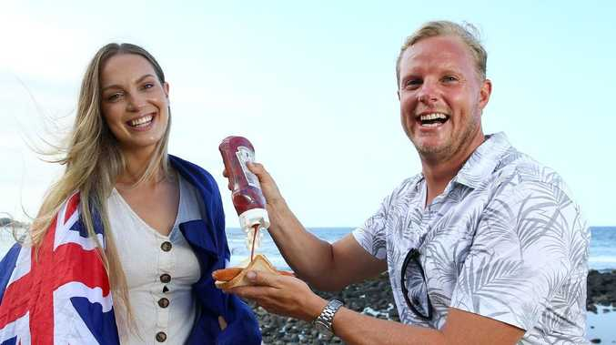 Kate and Richard Difford from Reedy Creek enjoy a barbecue at Burleigh Beach. Picture: Adam Head