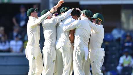 Mitchell Starc is the centre of celebrations after his 200th Test wicket.
