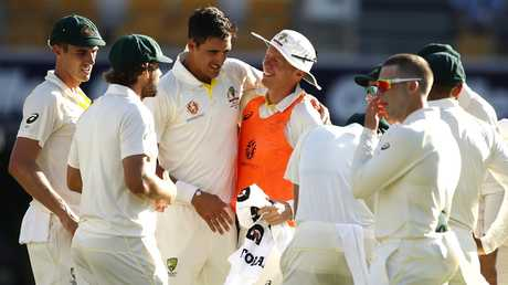 Peter Siddle got on the field to congratulate Mitch Starc on his 200th Test wicket..