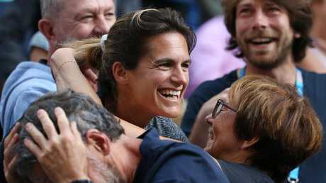Amelie Mauresmo gets hugs and kisses after Puoille wins. Pic: Michael Klein