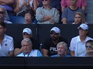 Husband steals the show after Australian Open win