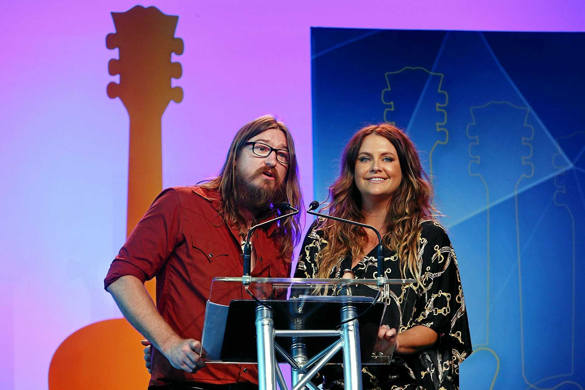 Brooke McClymont and Adam Eckersley presenting at the Golden Guitars last year. The husband and wife team are up for for four awards tonight, the first time as a duo.