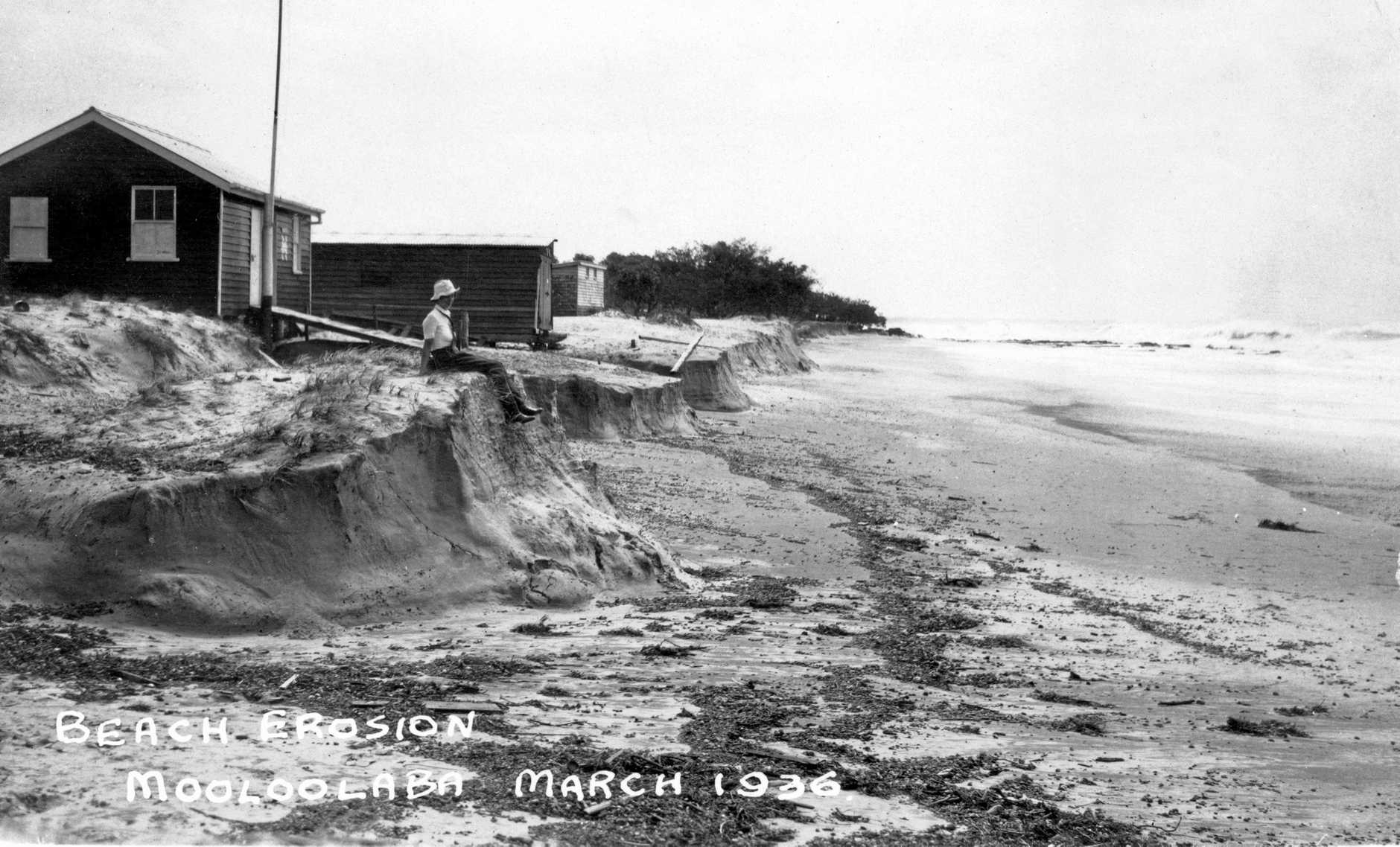 MOTHER NATURE'S FURY: Beach erosion due to cyclonic conditions near the Mooloolaba Life Saving Club buildings, Mooloolaba Beach, in March 1936.