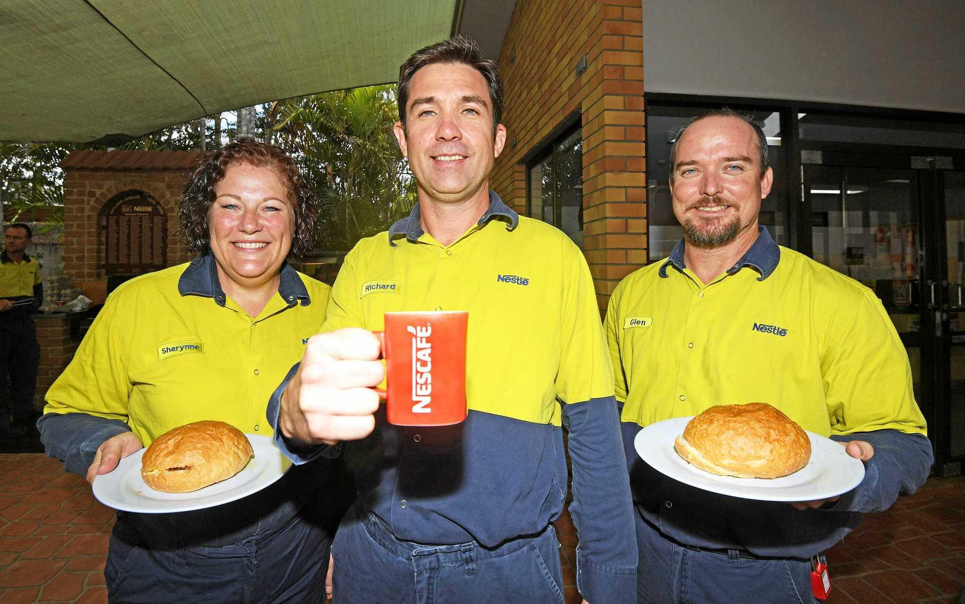 Sharynne Durbidge, with factory manager Richard Jones and Glenn Jones enjoy a decent pre-Australia Day breakfast.