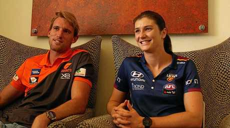 ON THE BALL: Gympie's Lachlan Keeffe and Jessy Keeffe meet before the AFLW GWS GIANTS and Brisbane Lion game.