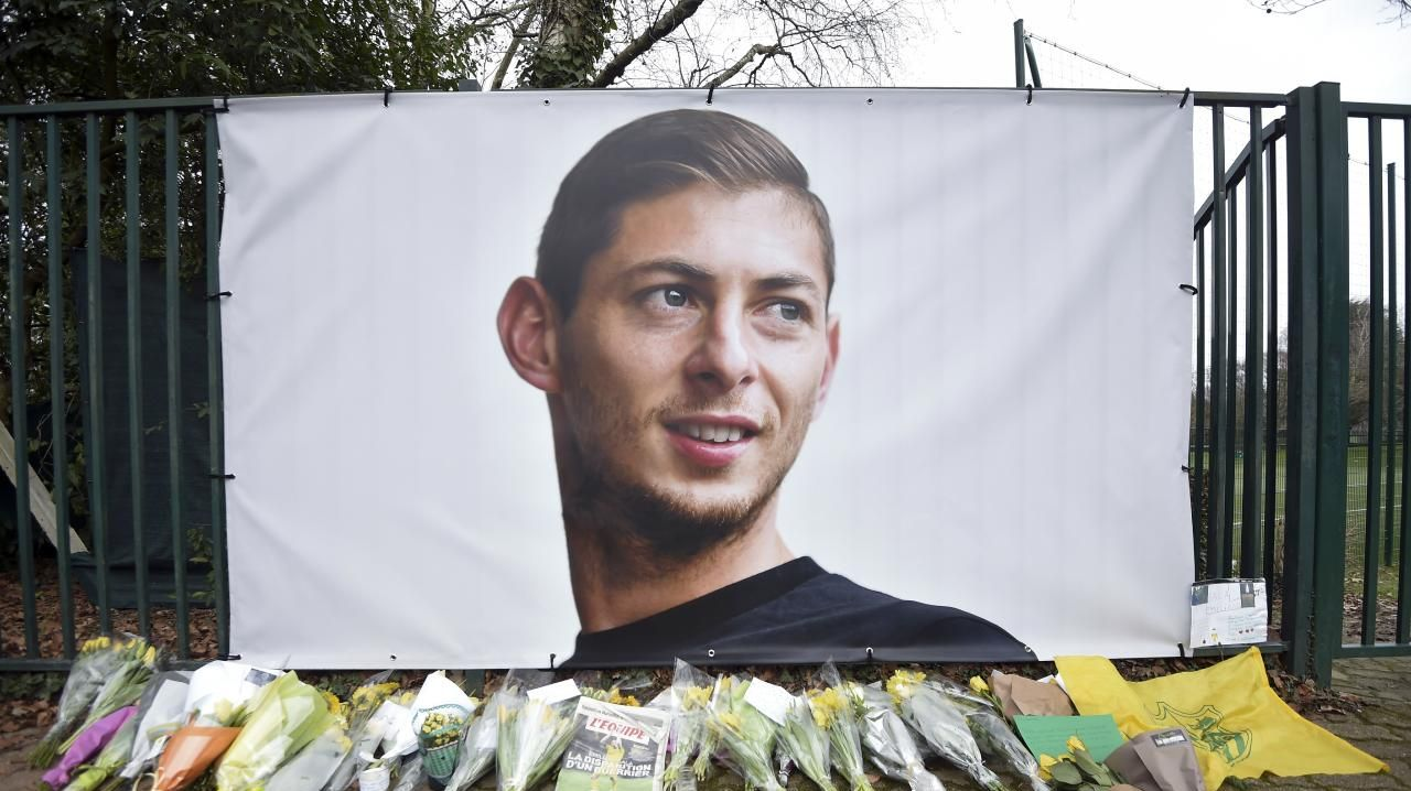 Flowers and tributes are placed near a giant picture of Argentine soccer player Emiliano Sala outside the FC Nantes training camp. (AP Photo)