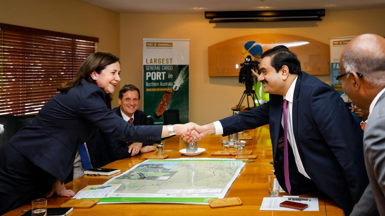 Adani Group chairman Gautam Adani meets with Queensland premier Annastacia Palaszczuk at the Port of Townsville in December 2016. (AAP Image/ Cameron Laird)