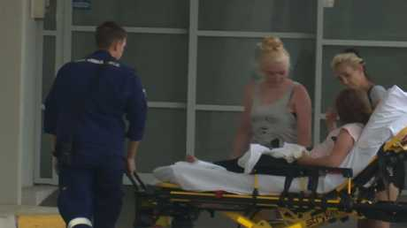 A 10-year-old girl who was bitten on the back is transported to hospital. Picture: TNV