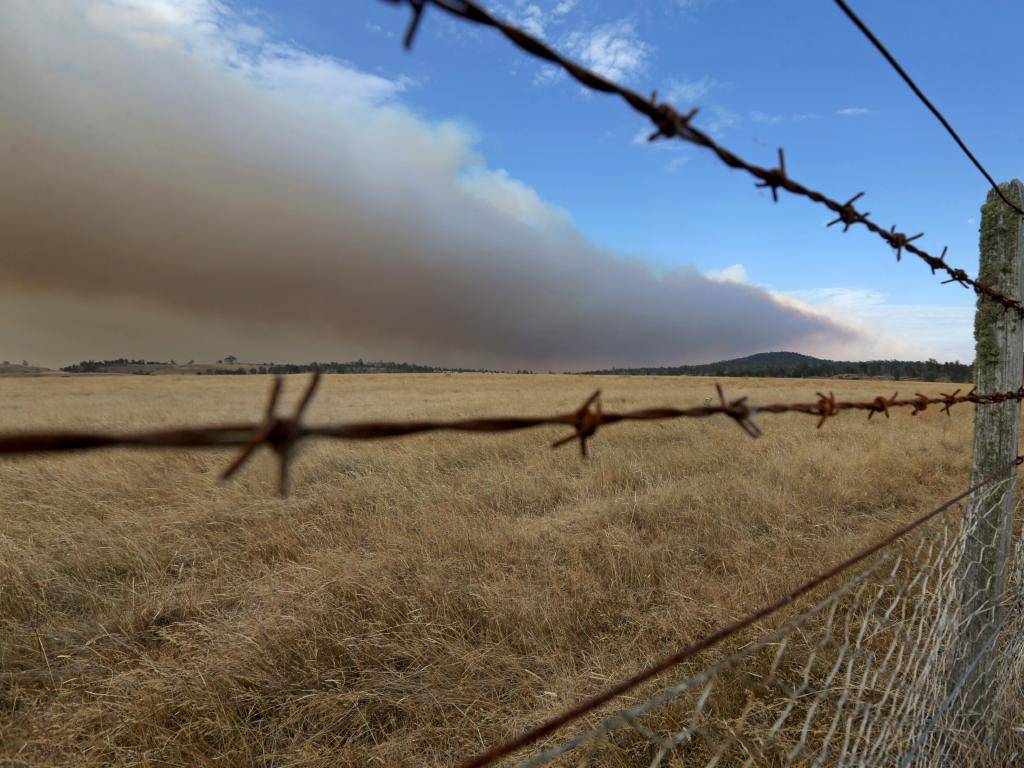 Smoke from Central Highlands fires blows across farmland near Bothwell. Picture: PATRICK GEE