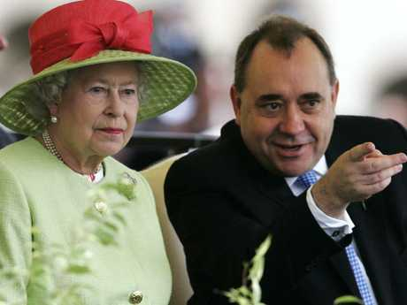 Britain's Queen Elizabeth II with Scotland's then First Minister Alex Salmond in 2012. Picture: AP