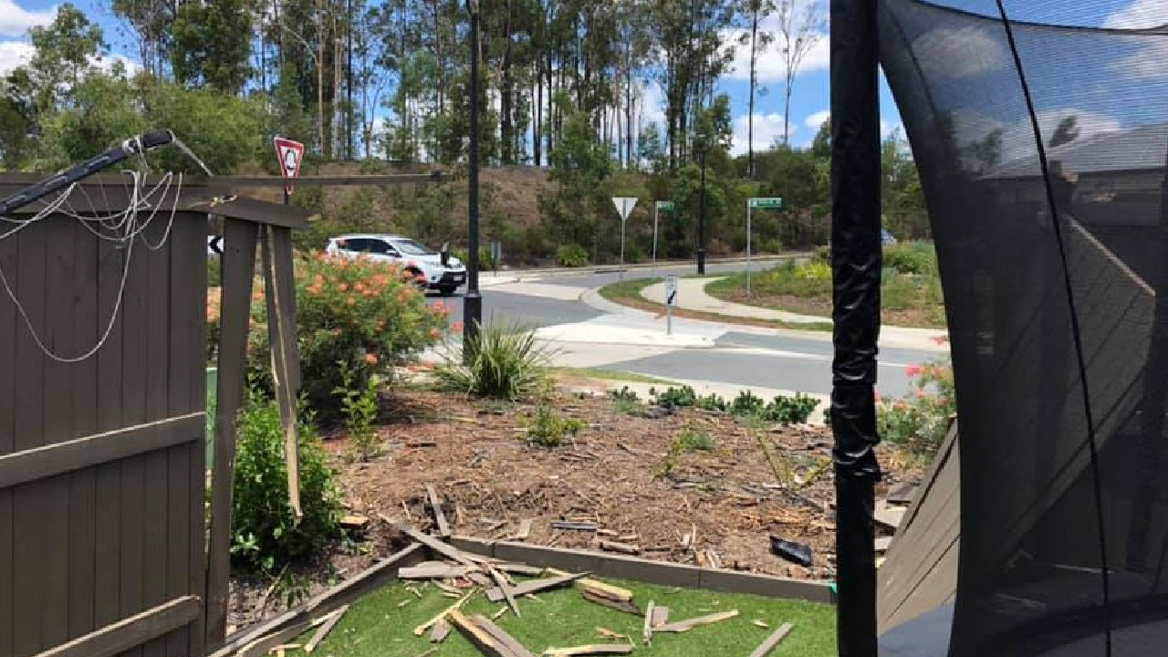 The view from Karl and Kerry Bird's house after a car crashed through their fence. Picture: Karl Bird