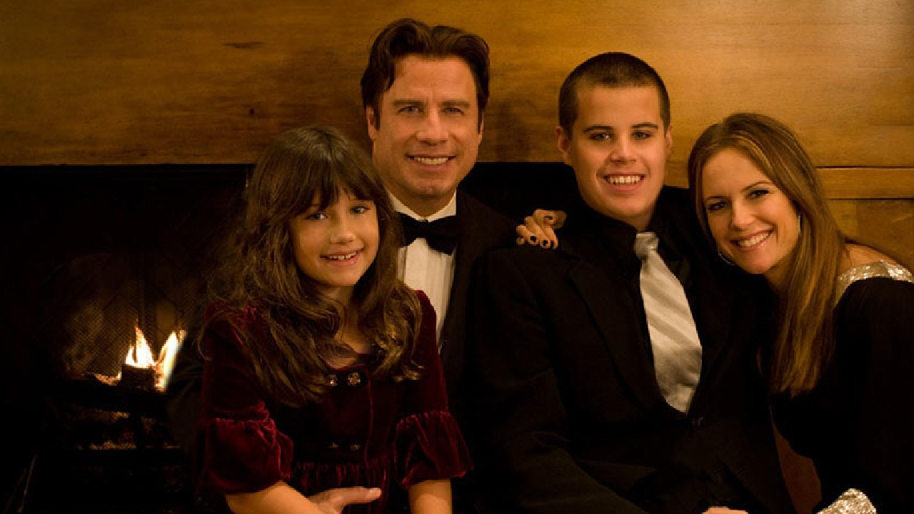 Travolta poses with his daughter Ella Bleu (L) and wife Kelly Preston and son Jett in an undated family photo.