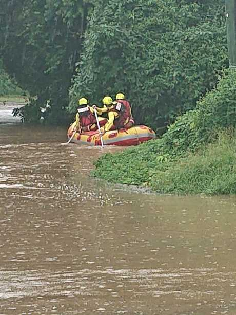 Crews are preparing to retrieve cars washed into a creek.