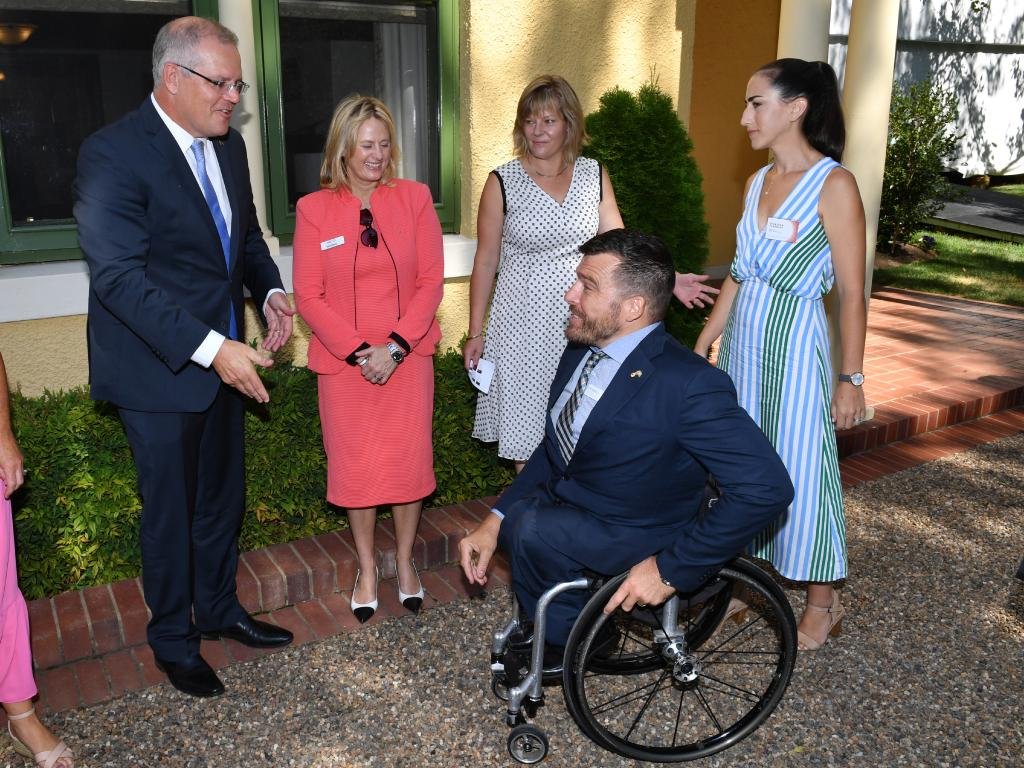 Prime Minister Scott Morrison meets with NSW 2019 Australian of the Year finalist Kurt Fearnley at the 2019 Australian of the Year finalist morning tea at The Lodge in Canberra. Picture: AAP