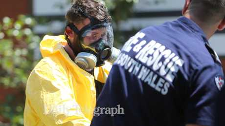 NSW Fire and Rescue officer wearing protective clothing about to enter the house.Picture: Tim Hunter.