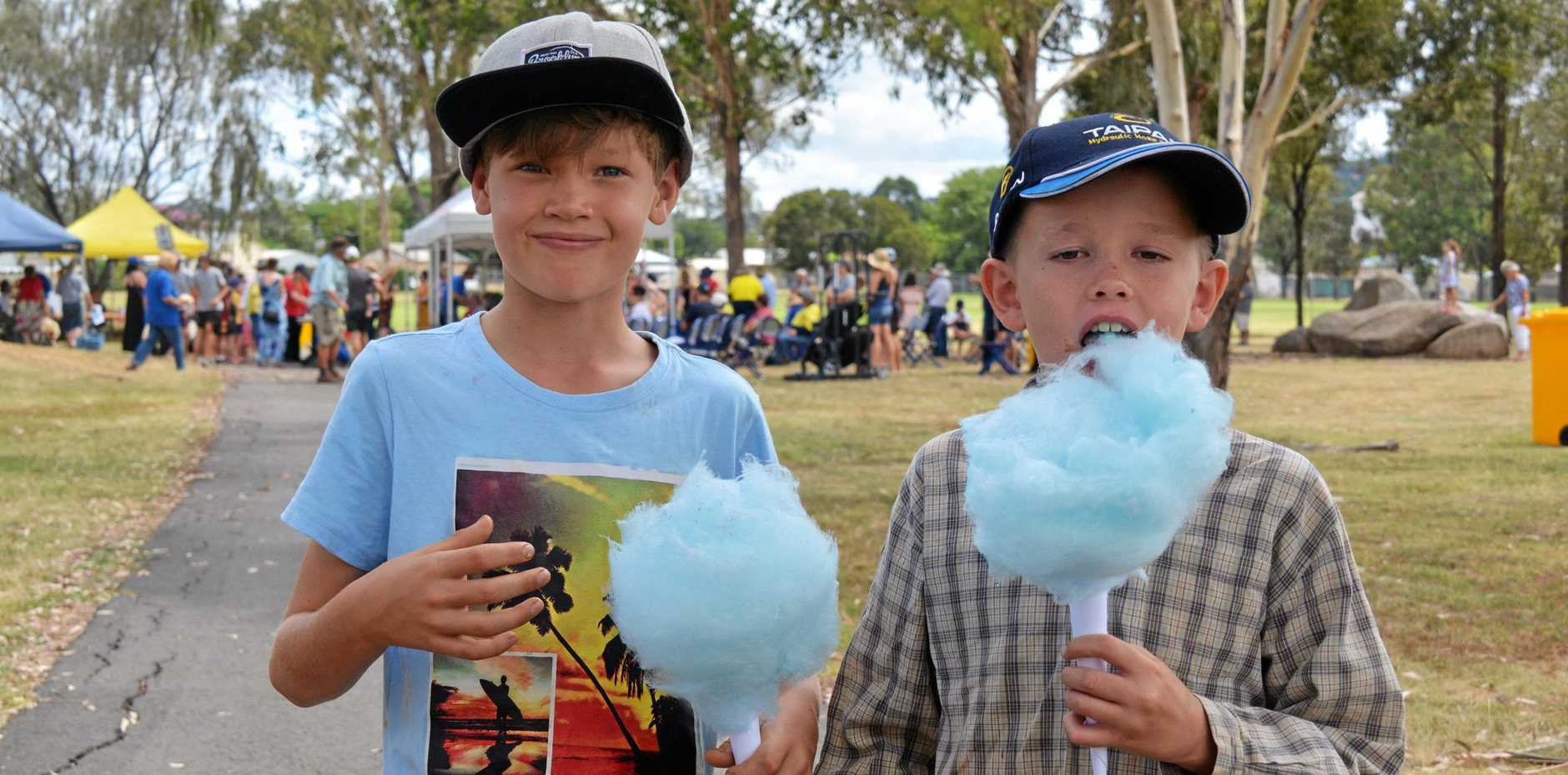 Stuart Reeves and Mitchell Prain try out the fairy floss at the 2019 Australia Day celebrations in Kingaroy on January 26.