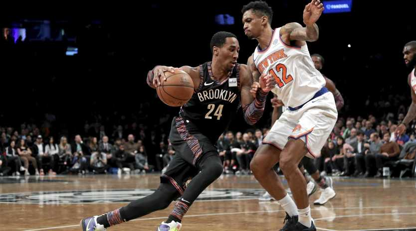 The Brooklyn Nets' Rondae Hollis-Jefferson drives forward as the New York Knicks' Lance Thomas defends during the second half. Picture: Frank Franklin II/AP