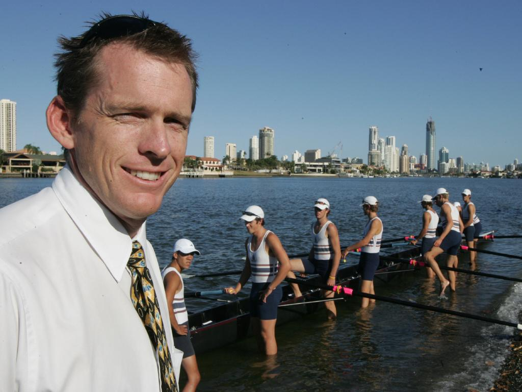 The 2005 TSS first rowing eight training on the Nerang River. Coach Duncan Free watches his team. Picture: Glenn/Hampson