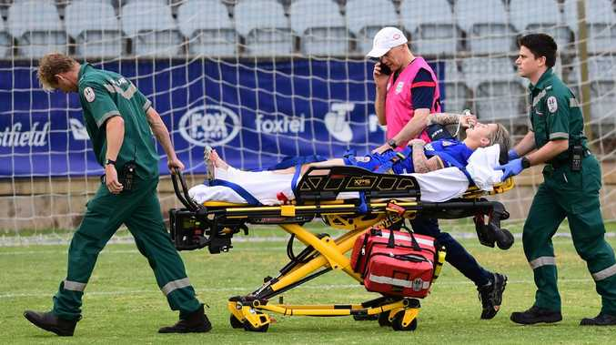 Larissa Crummer of the Newcastle Jets is taken off the field with a broken leg. Picture: Mark Brake/Getty Images