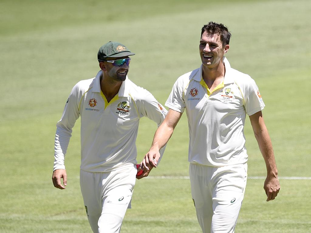 Pat Cummins is all smiles after taking two early wickets on day three of the first Test match between Australia and Sri Lanka at the Gabba. Picture: AAP