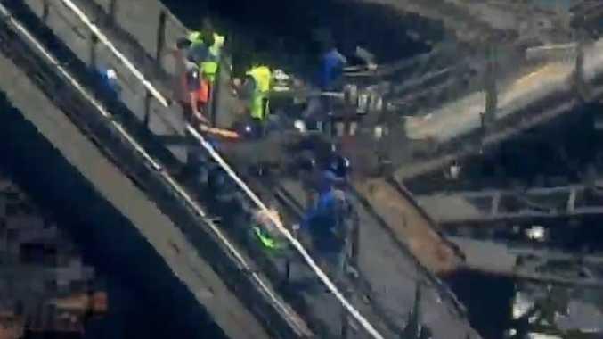 Paramedics working on Sydney Harbour Bridge. Picture: Channel 7