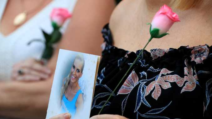 Janine Mackney, Breeana's aunt, holds a photo and a flower outside court today. Picture: Adam Head