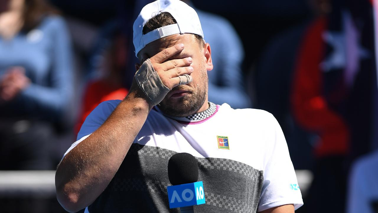 Dylan Alcott is overcome with emotion during his victory speech. Picture: Lukas Coch/AAP