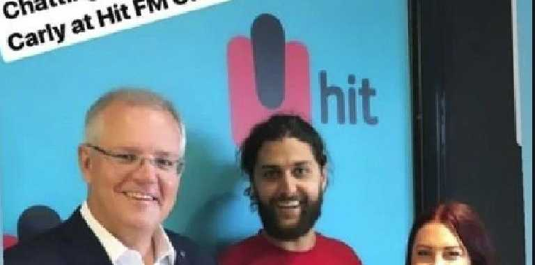 Cairns Hit FM host Shad Wicka has been fired from his employer Southern Cross Austereo after posing with an explicit mug alongside his co host Carly Portch and Prime Minister Scott Morrison. PICTURE: INSTAGRAM
