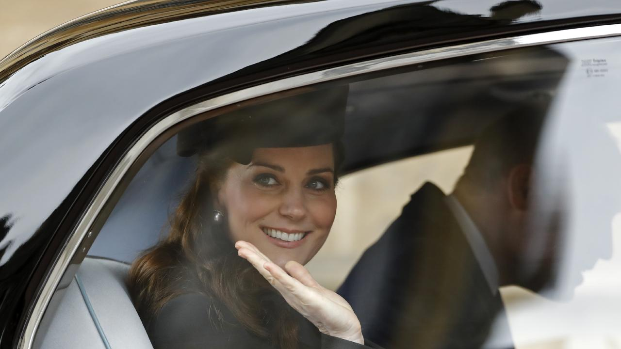 Catherine, Duchess of Cambridge showing off the Royal wave and no seat belt approach. Picture: Tolga Akmen — WPA Pool/Getty Images