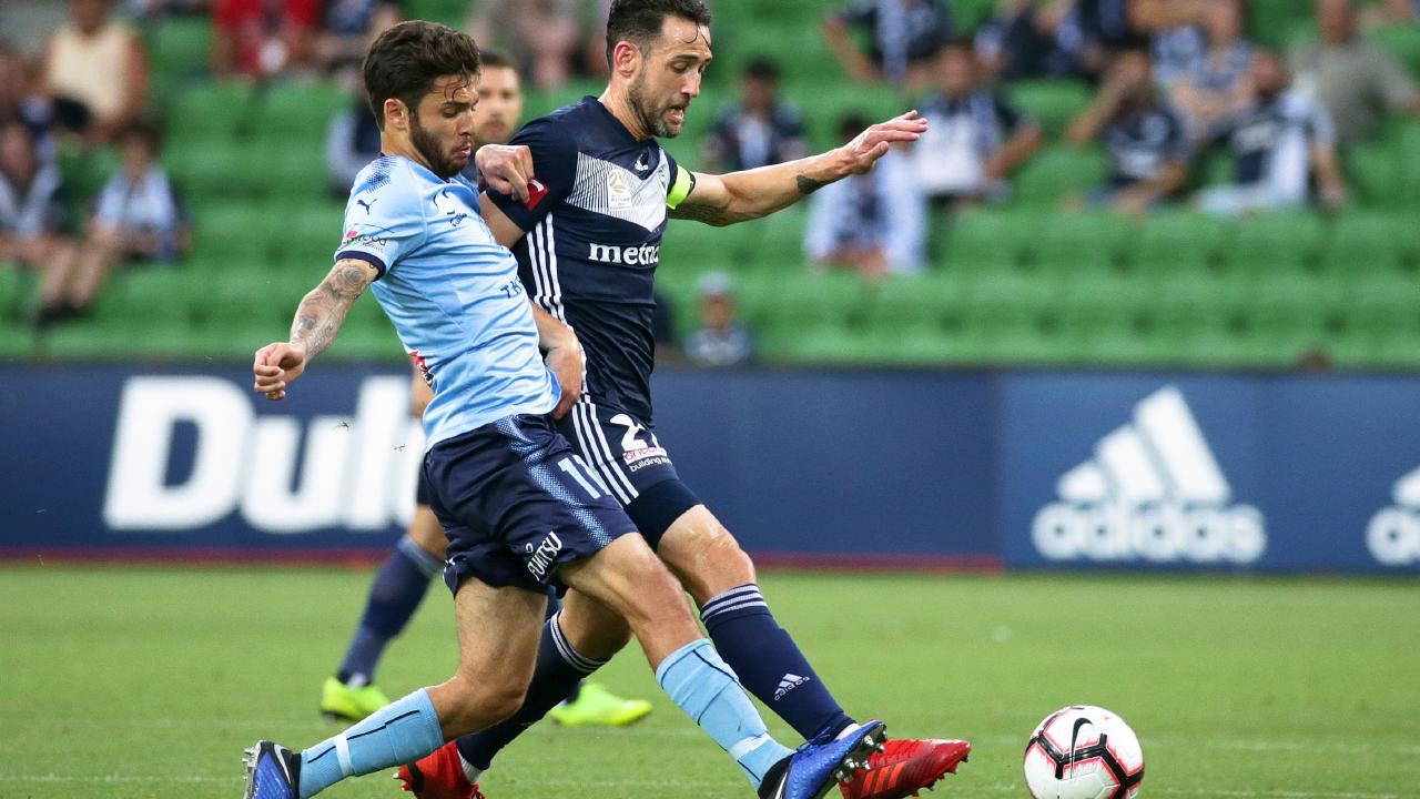 Daniel De Silva and Victory's Carl Valeri fight for possession of the ball.