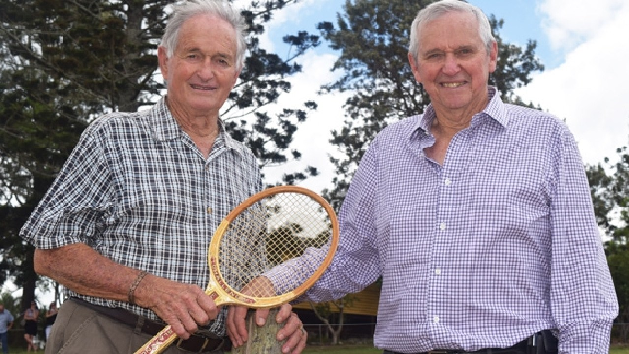 REVISITING ROOTS: Tennis heroes Mal Anderson and Roy Emerson test out the grass court Emerson learned to play on at the family farm at Nukku. Picture: Tessa Mapstone