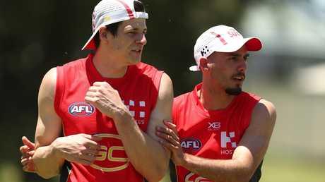 Gold Coast recruits Chris Burgess and Izak Rankine.