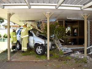 Elderly couple shocked after car crashes into house