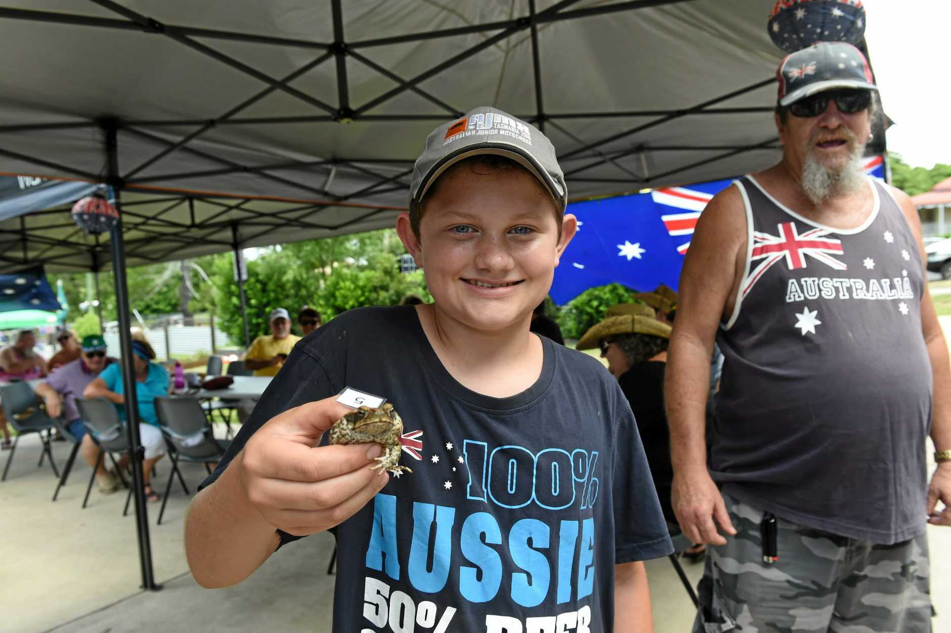 TRUE BLUE TIARO: Nate Coates with the winning toad 'Croaked It' after the toad races at the Tiaro Australia Day celebrations.