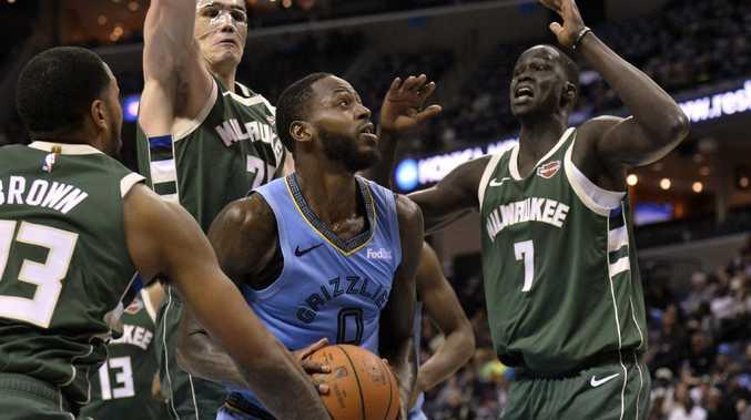 Memphis Grizzlies forward JaMychal Green looks to shoot between Milwaukee Bucks' Sterling Brown (23), Ersan Ilyasova (77) and Thon Maker (7).