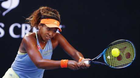 12 months ago... Naomi Osaka hits backhand in her straight sets defeat to Simona Halep. Picture: Michael Klein
